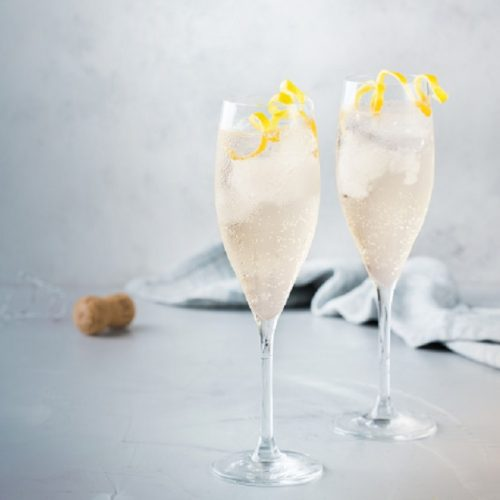 Food and drink, party holiday concept. Alcohol beverage cold cool champagne cocktail drink on a modern table for summer days. Copy space background