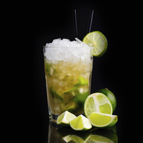Caipirinha cocktail with limes on a dark background